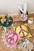 Cushions with appliqué peace symbols