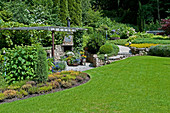 Pergola, flower beds and well-tended lawn in spacious garden