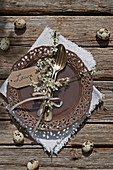 Twigs of blackthorn blossom tied to cutlery decorating place setting
