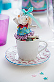 Circus elephant in teacup decorating table for child's birthday party
