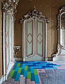 Blue floor in interior of historic building with Baroque doors