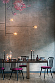Set dining table cosily lit with candles and lamps