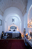 Bedroom with arched vaulted ceiling cosily decorated for Christmas