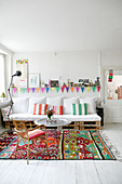 Pallet sofa in living room with white floor and brightly coloured accents
