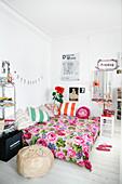 Floral bedspread on bed in teenager's bedroom