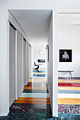 Marble floor made from strips of various colours in designer apartment