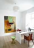 Designer chairs at desk in simple study