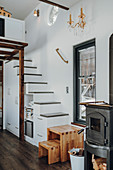 Stools at foot of staircase with integrated storage space in tiny house