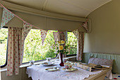 Bunting and set table in vintage-style caravan