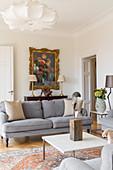 Grey velvet sofa in classic living room