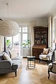 Velvet sofa and bureau in classic bedroom