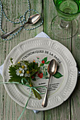 Posy of wild strawberry flowers decorating plate