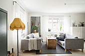 Two grey sofas facing one another in vintage-style living room