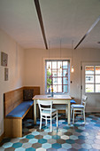 Dining area with corner bench in kitchen-dining room with tiled floor