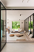 Summery, Bohemian-style loggia in modern, architect-designed house
