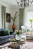 Classic, elegant living room with panelled walls in period building