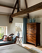 Old chest of drawers in classic bedroom with exposed wooden beams