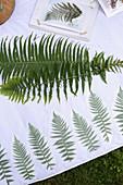 Handmade picnic blanket with fern motifs