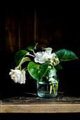 Glass vase of white roses
