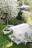 View down into garden with summerhouse and old boat