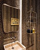 Leopard-print wall in eccentric bathroom