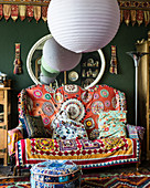 Spherical lampshades and colourful, exotic accessories in living room