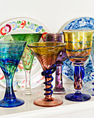 Old wine glasses made from coloured glass