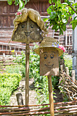 Garden decorations handmade from rusty gardening implements