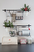 Christmas decorations on wall-mounted storage rails in kitchen