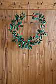 Handmade wintry wreath of paper leaves