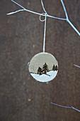 Suspended, poker work winter landscape on disc of wood