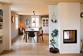 Modern interior in country-house-style with fireplace and dining area