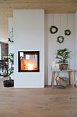 Lit fire in insert stove in rustic interior