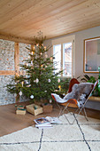 Simply decorated Christmas tree in rustic living room