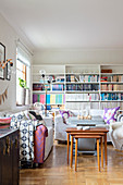 Tidy bookcases and white sofas in living room