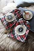 Tartan sachets with numbered paper rosettes