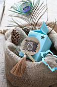 Pale blue gift bag with tag in jute sack