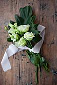 White eustomas tied with ribbon