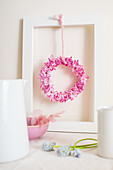 Small wreath of pink hyacinths florets in picture frame