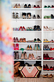 Ladies' summer shoes on white shelves