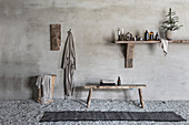Bathroom utensils on wooden shelf, wooden bench, bathrobe and laundry basket