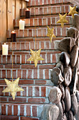 Steps festively decorated with pillar candles and golden stars