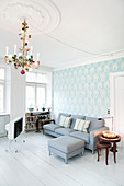 Chandelier, pale blue paper and white floor in living room