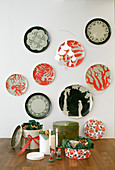 Decorative wall plates in black and coral red above biscuits in biscuit tins
