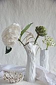 Hydrangeas, artichoke, star-of-Bethlehem and amaranth in white vases