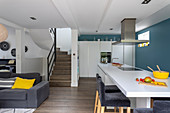 Kitchen island with table extension in open-plan interior