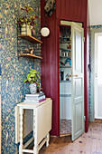 Open panelled door leading into pantry in country-house kitchen