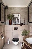 Toilet in classic bathroom with panelled wainscoting