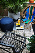 Designer furniture in seating area on summery balcony