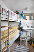 Bunk beds and sink in small shabby-chic room